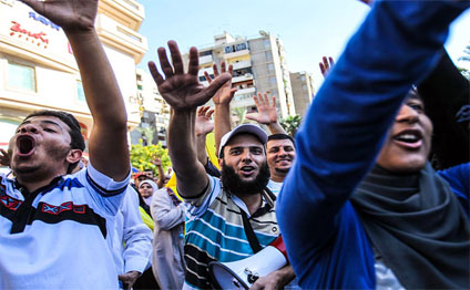 Pro-democracy protesters rally in support of Al-Azhar students