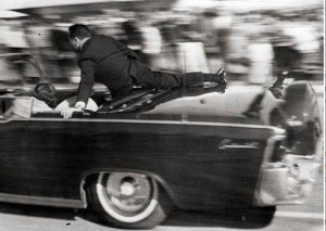 Secret Service Special Agent Clint Hill climbs onto the Presidential limousine, seconds after the fatal shot. (Image: Courtesy of Wikipedia)