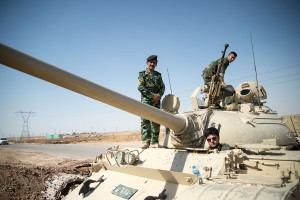 Peshmerga on a T-55 tank outside Kirkuk in Iraq (Courtesy: Wikipedia)