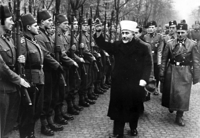 November 1943 al-Husseini greeting Bosnian Waffen-SS volunteers with a Nazi salute. At right is SS General Karl-Gustav Sauberzweig. (Photo: Courtesy of Wikipedia)