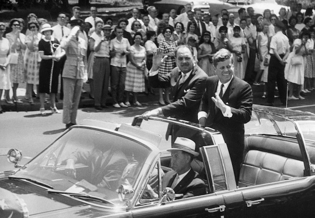President Mohammad Ayub Khan of Pakistan in a motorcade with President John F. Kennedy as they drive through Washington, DC (Photo by White House: Courtesy of WikiCommons)