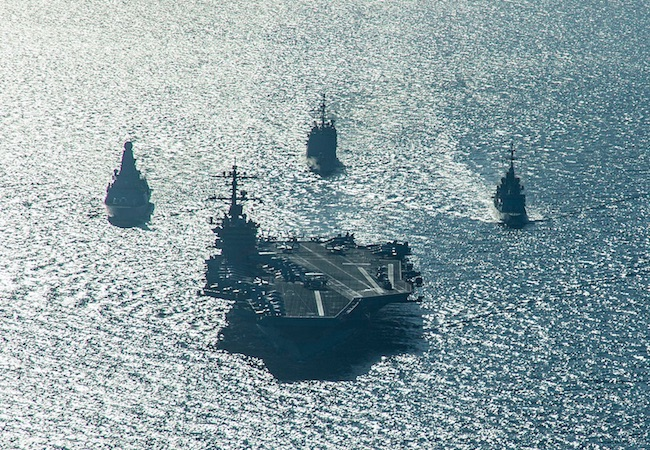 The USS Carl Vinson and support ships deployed for combat operations in Syria and Iraq. (Photo by US Navy: Courtesy of WikiCommons)