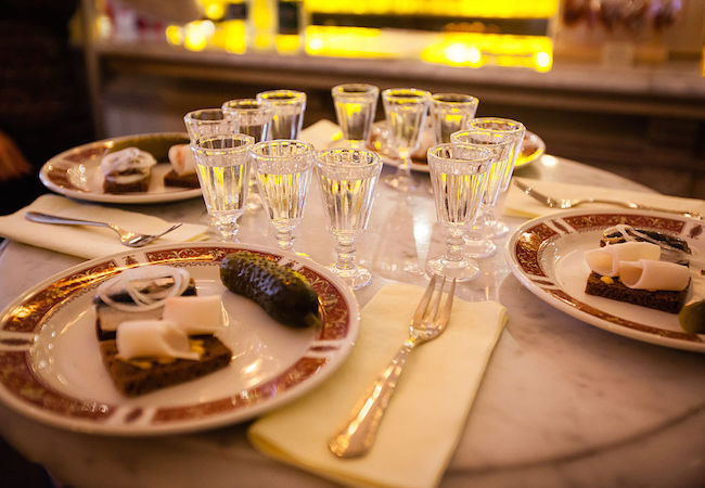 Traditional Russian table with vodka, smoked bacon and marinated chasers (Photo: Courtesy of WikiCommons)
