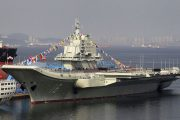 Tension mounts as strong Chinese fleet of aircraft carrier and navy vessels spotted south of Taiwan
